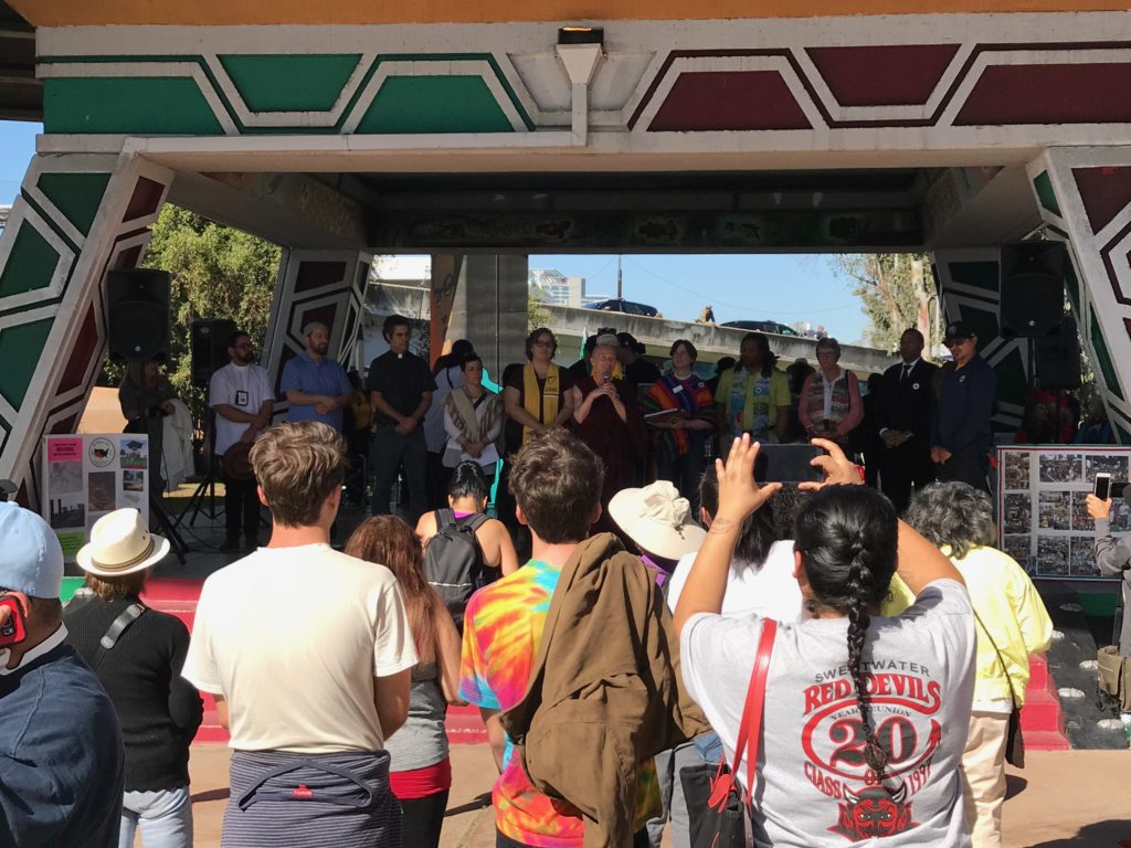 Multiple leaders speaking to audience during Chicano Park rally